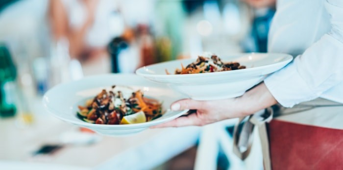 An upcoming event will benefit Mind the Bar, and organization that helps Vancouver's hospitality industry workers manage mental health issues and workplace harassment. Photo: Restaurant server/Shutterstock
