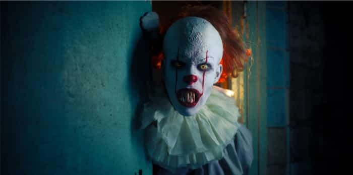 Photo: Dnipro, Ukraine - September 8, 2019: Portrait of a cosplayer in the image of a Pennywise the Dancing Clown from horror movie