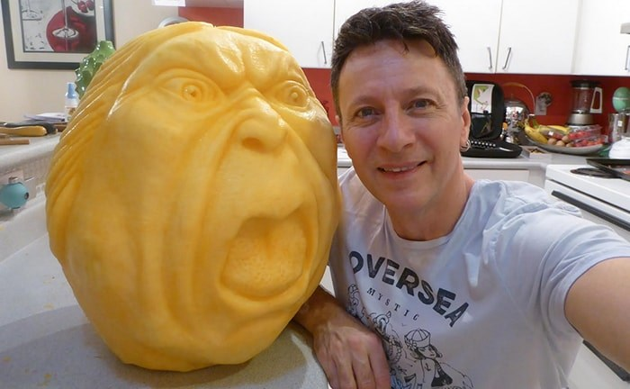 Clive Cooper with one of his pumpkin carvings. Photo: Sparksfly design