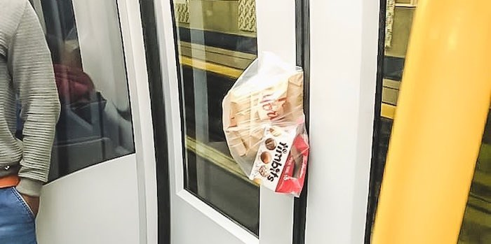 A passenger threw their Tim Hortons bag at the closing SkyTrain doors in the hopes it would hold the train for them.