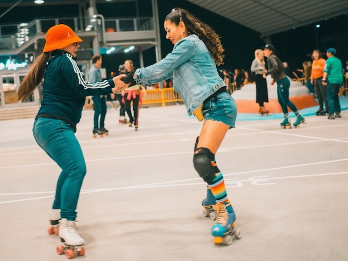 Roller skaters show off their moves at a Pop Up Roller Rink held at North Vancouver's Shipyard Commons Oct. 5. The good times will roll again Friday, Nov. 1 at a Halloween-themed roller skate at the same location. Photo courtesy Rollerskate Vancouver/Rolla Skate Club