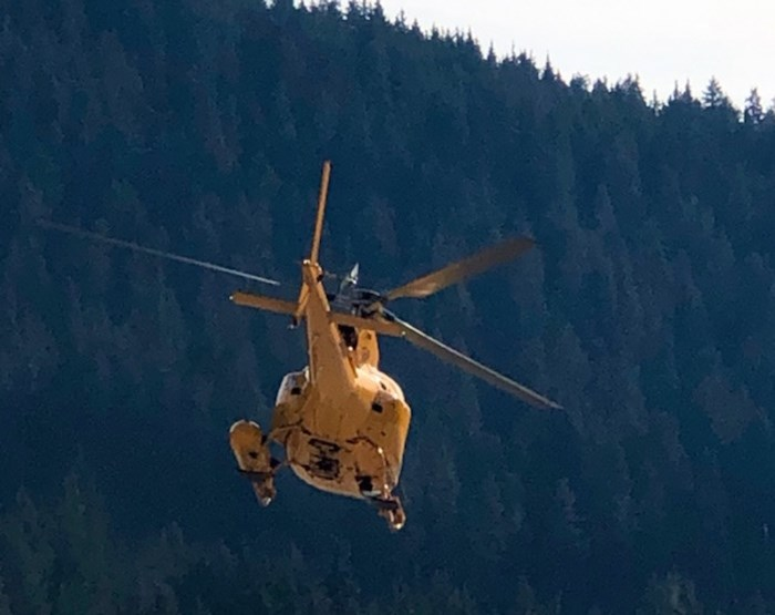 A Talon helicopter comes in to land at the Cypress SAR command centre in West Vancouver Thursday morning. Searchers from Lions Bay and the North Shore have been combing the backcountry with the help of Talon helicopters after a 25-year-old hiker went missing from the Howe Sound Crest Trail Wednesday afternoon. Photo Mike Wakefield, North Shore News.