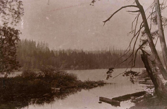 A 1900 photo of Deer Lake included in the Burnaby Village Museum's new Indigenous History in Burnaby Resource Guide shows a shallow dugout Indigenous canoe of the kind once used by Sḵwx̱wú7mesh and hən̓q̓əmin̓əm̓ ancestors to navigate local riverways. City of Burnaby Archives