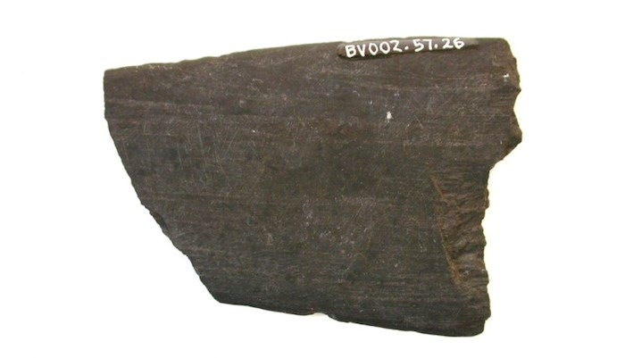 This stone knife, likely used to cut and prepare fish for drying racks, is thousands of years old. It was found near the current site of Burnaby Village Museum. The Deer Lake area was once an important fishing site for hən̓q̓əmin̓əm̓ and Sḵwxw̱ ú7mesh people. - Burnaby Village Museum