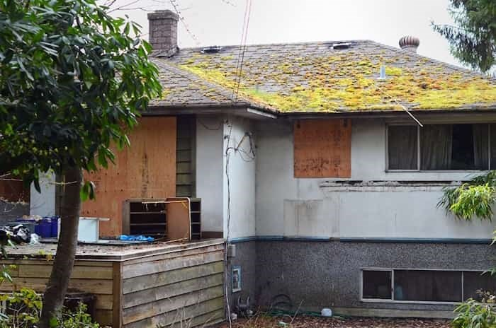This Sumas Street house was boarded up after a major fire last year. Photo: Cornelia Naylor