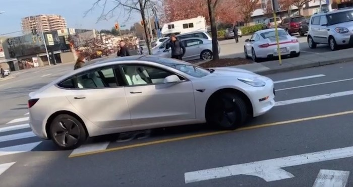 A video shows a driverless Tesla moving through Richmond Centre's parking lot on Monday, Nov. 4, 2019. Screenshot