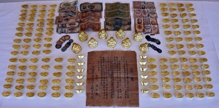 A Chinese gold scam that first appeared in Richmond in 2010 could be returning to the city, according to Richmond RCMP. Common items used in the scam include fake gold Buddha figurines and gold ingots, as well as handwritten wills or letters. Photo courtesy Richmond RCMP