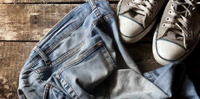 Return-It recycling is expanding its capacity to recycle old or unwanted clothing, household textiles and shoes at 32 locations across B.C. Photo: Old jeans and shoes/Shutterstock