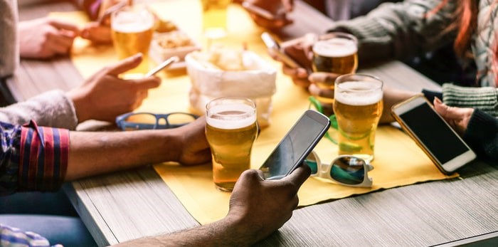 How are social media influencers shifting the culture of craft beer? Photo: Beer and cellphones/Shutterstock