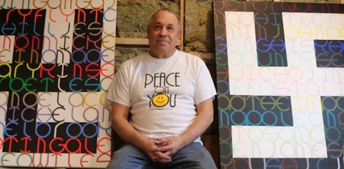 James Miller with two of his works that incorporate the swastika. Photo: Citizen file photo