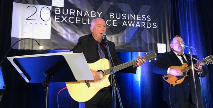 Burnaby Mayor Mike Hurley singing about Burnabarians Thursday night at the annual Burnaby Board of Trade business awards. Chris Campbell photo