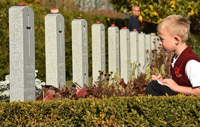 Students from St. Mary's elementary school, St. Francis de Sales, St. Catherine's Langley and St. Helen's School joined soldiers from the 39th Brigade to place poppies at veterans' gravesites at Mountain View Cemetery on Wednesday. Photo Dan Toulgoet