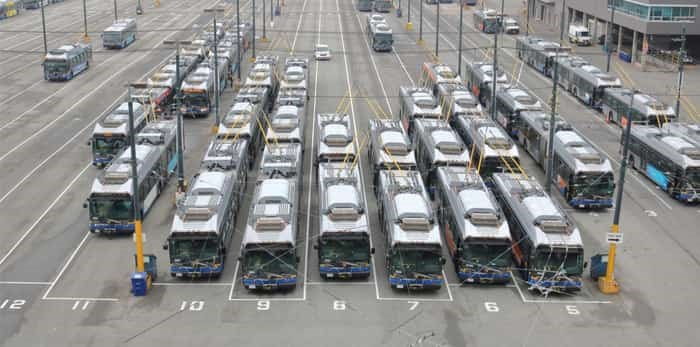 Photo: VANCOUVER - September 8, 2017: A high angle view of many commercial city buses parked in the terminal station in south Vancouver, Canada on September 8, 2017 / Shutterstock
