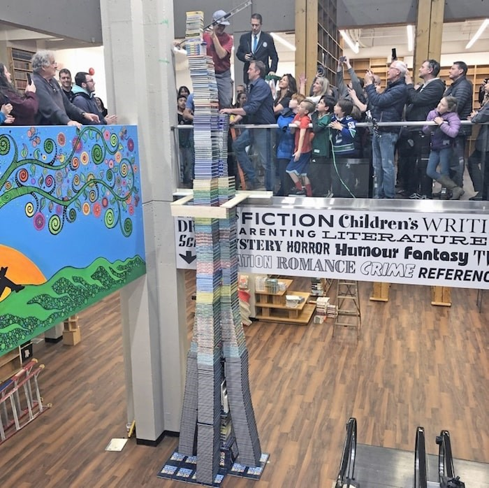 Russell Books attempts to achieve a Guinness World Record title for the tallest tower of Guinness World Records books on Thursday, Nov. 14, 2019. Photo by Jeff Bell/Times Colonist