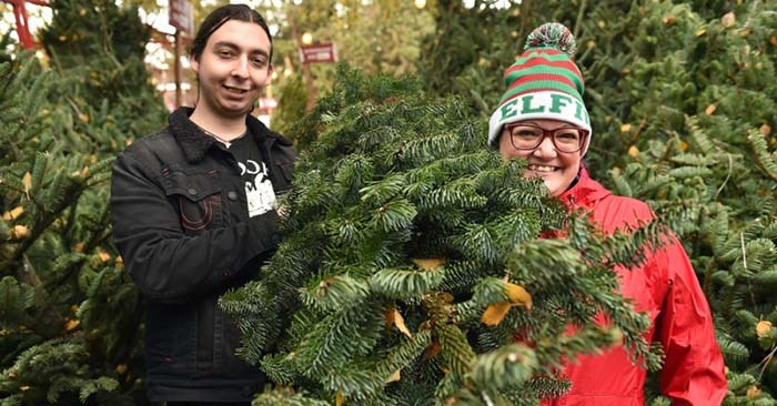 Roy and Angelina Oates at the Aunt Leah's Christmas Tree Lot at St. Stephen's Church on Granville Street. Photo Dan Toulgoet