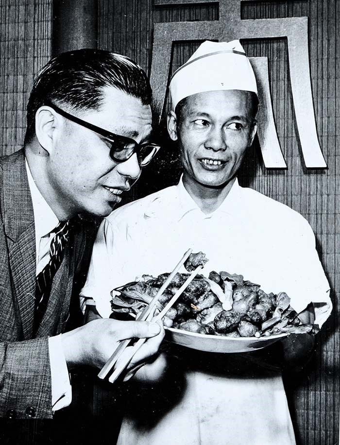 Owner Victor Louie samples his chef's offering from Marco Polo's 14-page menu. Photo courtesy of Tom Carter Archives
