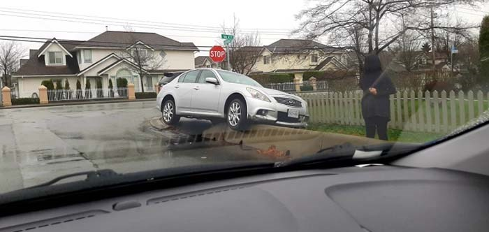 A silver car somehow came to a stop on a concrete barrier at the corner of No. 4 and Alexandra roads.