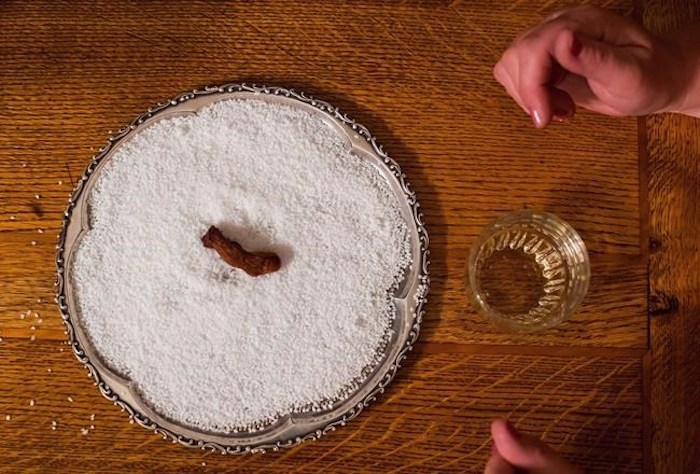 A dehydrated human toe that is used in the Sourtoe Cocktail rests on a bed of salt at the Downtown Hotel, before being dropped in a shot of whisky for a customer, in Dawson City, Yukon, in Dawson City, Yukon, on Sunday, July 1, 2018. The founder of the legendary Sourtoe Cocktail, a shot of Yukon whisky poured over a pickled human big toe, has poured his last drink. Dick Stevenson, the former Dawson City, Yukon bartender known worldwide as Captain Dick, has died. He was 89. THE CANADIAN PRESS/Darryl Dyck