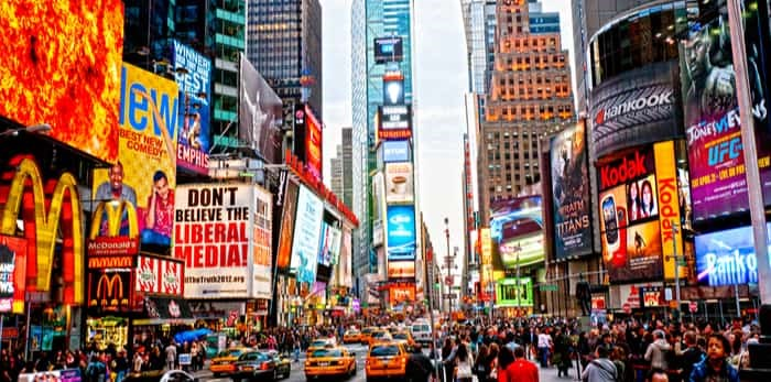 Photo: NEW YORK CITY -MARCH 25: Times Square, featured with Broadway Theaters and animated LED signs, is a symbol of New York City and the United States, March 25, 2012 in Manhattan, New York City. USA. / Shutterstock