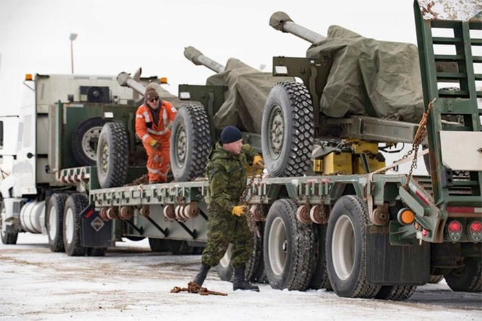 The 105-mm Howitzers are loaded onto trucks in Manitoba. Photo Maritime Forces Pacific Facebook