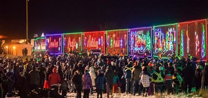 Decked out in glowing lights, the CP Holiday Train will once again journey across Canada collecting food and raising funds for food banks across North America. Photo: CP Holiday Train