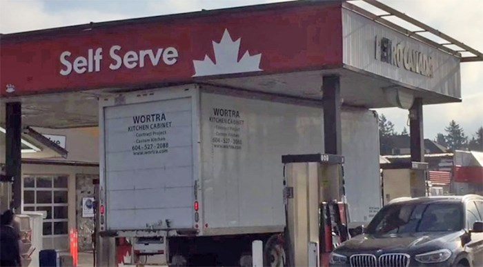 A delivery truck in a tight spot at the Petro-Canada gas station at 56th St. and 12th Ave. in Tsawwassen Friday.