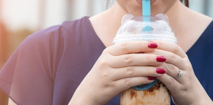 Vancouver's bubble tea businesses will have an extra year to figure out how to tackle the plastic straw ban. Photo: Drinking bubble tea/Shutterstock