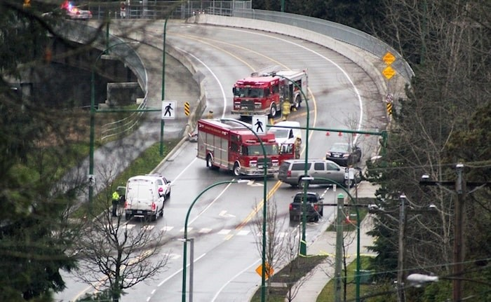 Emergency crews attend the site of a fatal crash on Cariboo Road in January that saw a 15-year-old girl killed on a controversial crosswalk. Burnaby NOW file photo