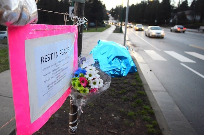 A memorial sprung up by a crosswalk at the bottom of Cariboo Hill after a 15-year-old girl was hit by a vehicle and killed while walking in the area. Photo by Cornelia Naylor