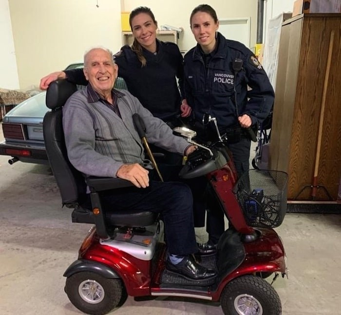 Vancouver police officers this week reunited a West Vancouver air force veteran with his stolen scooter. Photo courtesy Vancouver Police Department