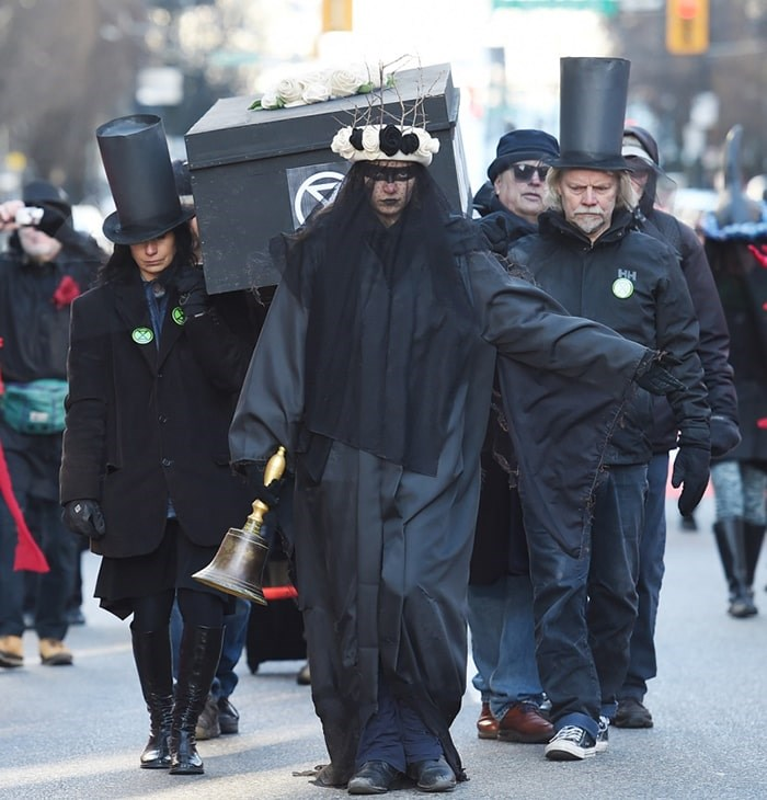 Extinction Rebellion Vancouver staged a funeral procession and wake for the planet downtown Friday afternoon. Photo Dan Toulgoet