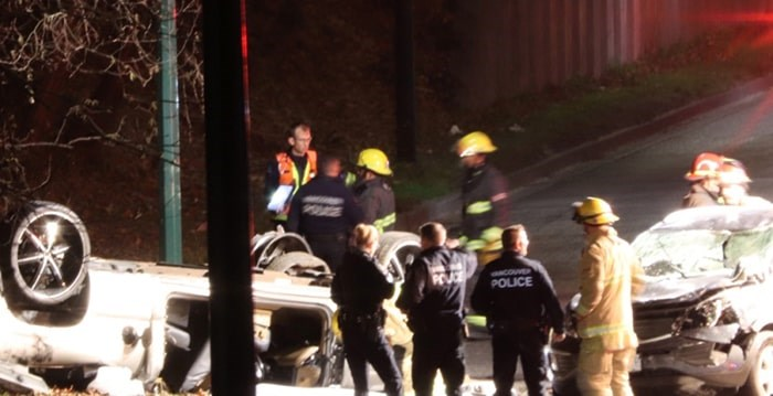 The driver of a pickup truck heading southbound on Boundary Road in Burnaby lost control and rolled the vehicle across into the northbound lanes, colliding with a car before landing on its roof. Shane MacKichan photo