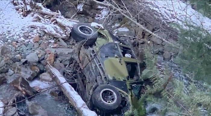 A vehicle that was carrying seven people lies on its side in a river bed after rolling down a steep embankment early Friday. Nov. 29, 2019. Photo: CHEK News