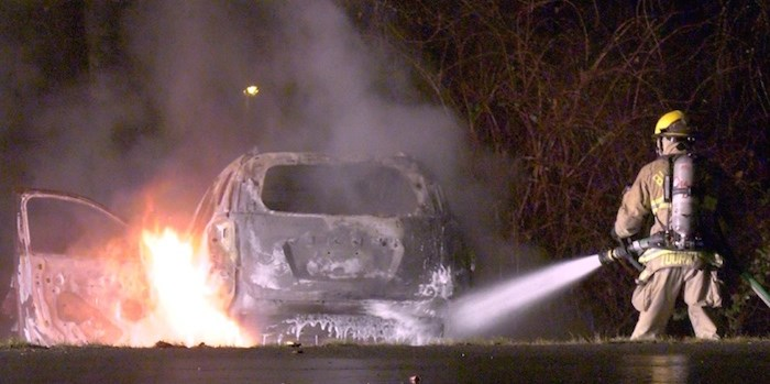 A vehicle was found in flames this morning at Fraser Park Drive and Byrne Creek Road in South Burnaby. Photo courtesy Jordan Jiang/CTV