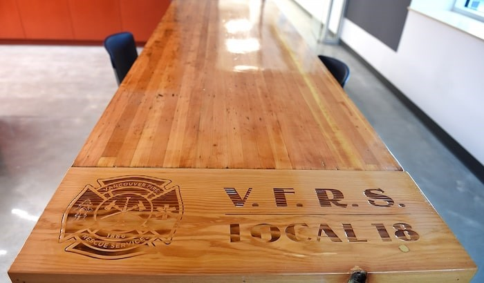 A firefighter made this wooden table out of a workbench from the old Firehall No. 5. Photo Dan Toulgoet