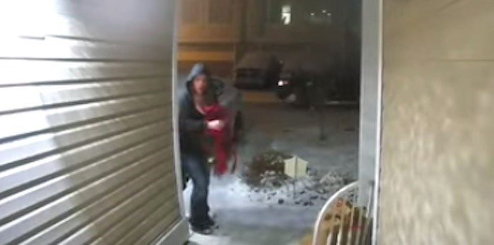 A woman was caught on camera stealing Christmas decorations from a home in West Kelowna late Sunday night. Screenshot/YouTube