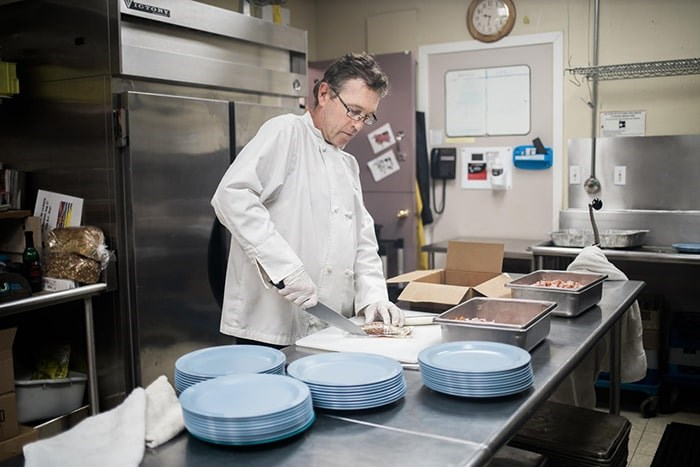 On Saturday, formerly homeless Vancouver chef Mike Miller will be busy in Union Gospel Mission's kitchen helping to prepare the charity's annual holiday feast.. Photo: UGM/Andrew Taran