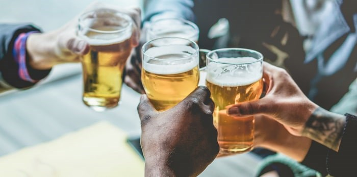 Cheers to the best in B.C. beer for 2019, according to readers of The Growler. Photo: Drinking beers with friends/Shutterstock