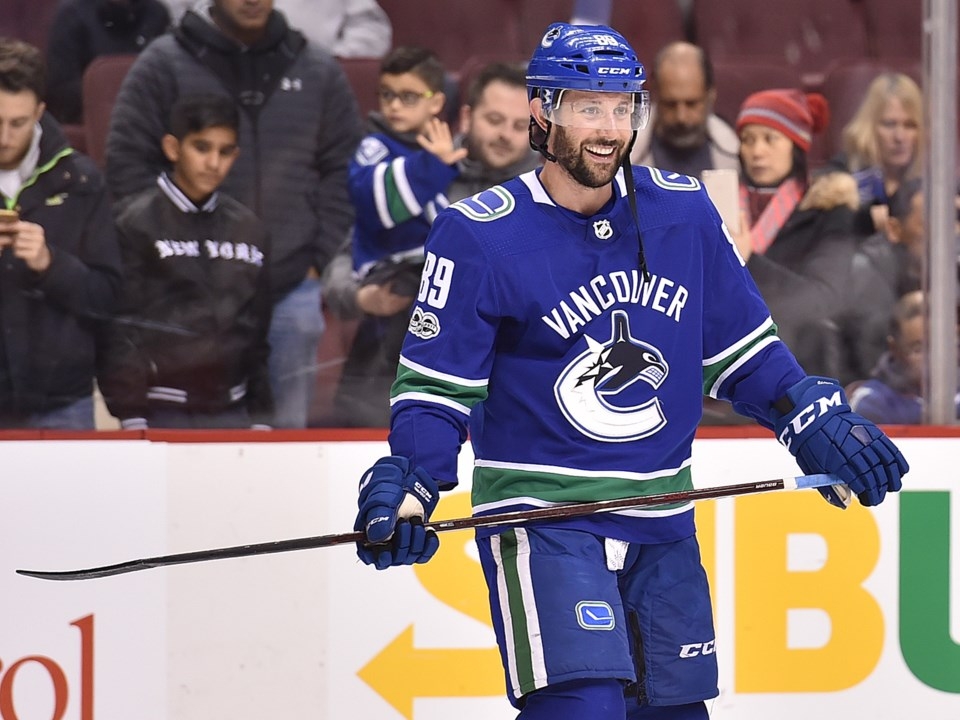Sam Gagner smiles while warming up with the Canucks.
