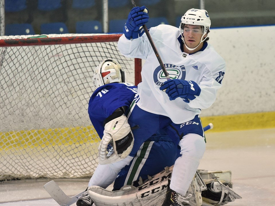 Jack Malone battles in front of the net with Arturs Silovs at Canucks 2019 development camp.