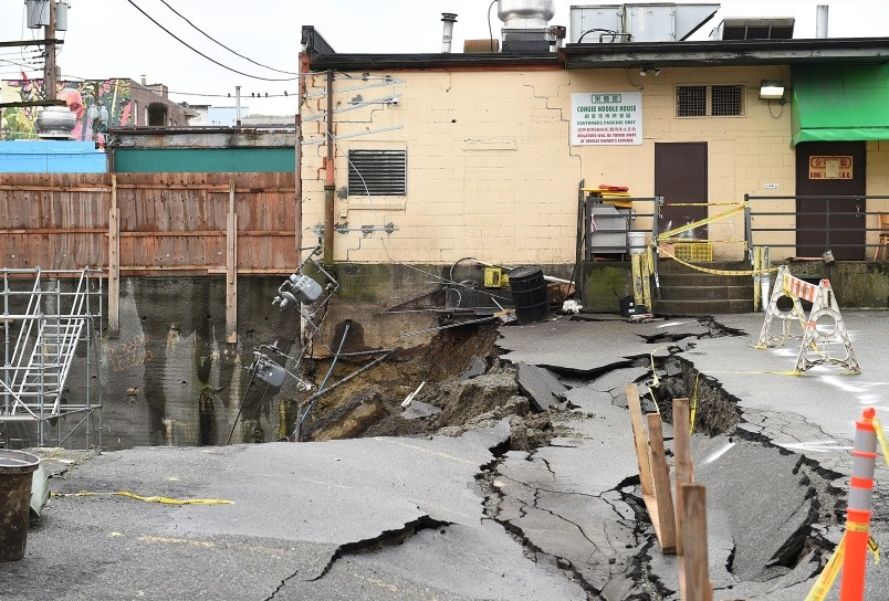 On Jan. 31, the retaining wall of a construction site came down during heavy rainfall on, causing a section of the Congee Noodle House parking lot to cave in and slide into the neighbouring excavation pit. Photo Dan Toulgoet