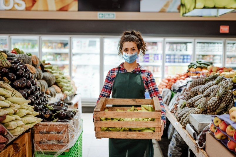 covid-19-grocery-store-worker-stock-photo