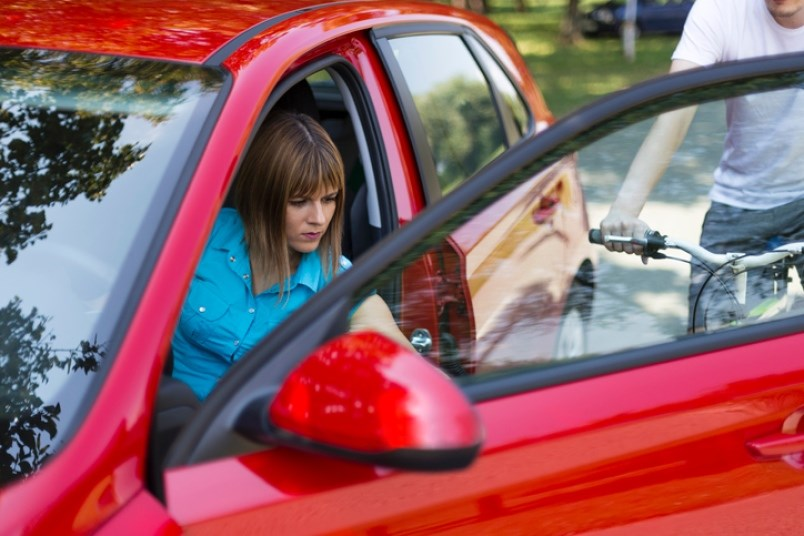 dooring-is-often-associated-with-opening-up-a-car-door-as-a-cyclist-is-passing-by