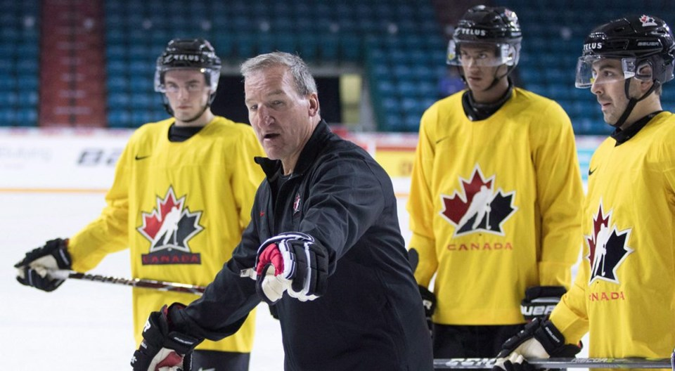 Tim-Hunter-Canada-coach-Jeff-Bassett-CP