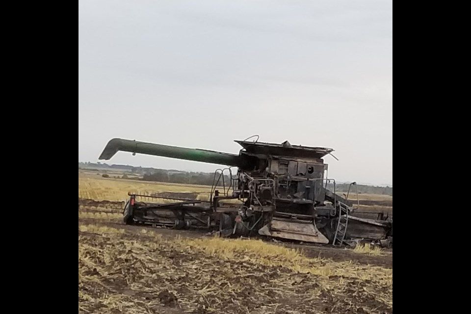 In this field along Hwy 21 is Carter's charred combine.