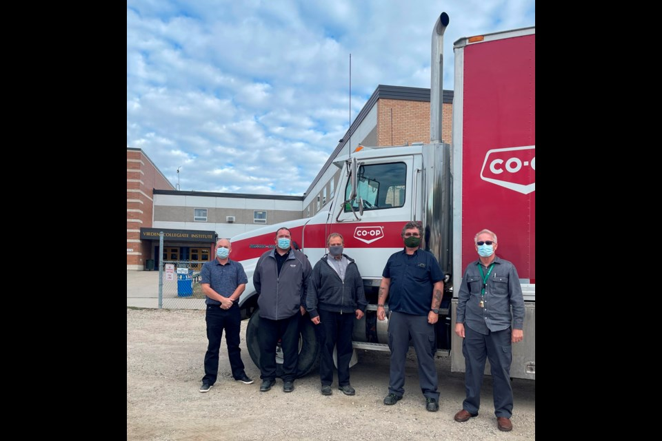 Valleyview support is acknowledged by VCI: (l-r) Mark Keown, Principal VCI; James Rolfe, Petroleum Division Manager Valleyview Co-op; Jon Waines, Bulk Oils Products Manager; Darren Denty, Power Mechanics Teacher; Timothy Froese, Power Mechanics Teacher.