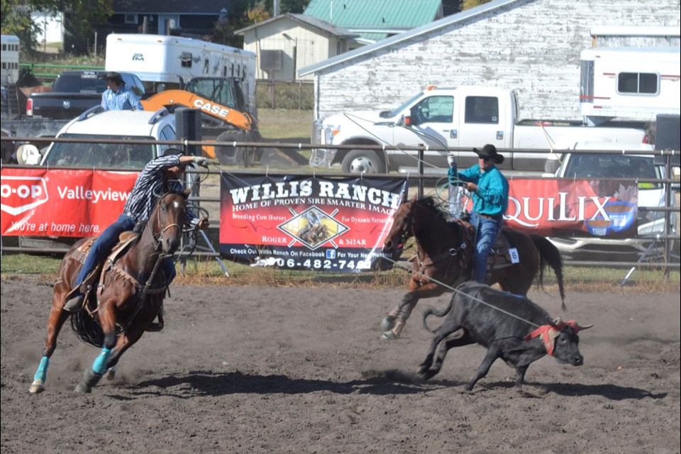 Justin Bridgeman, (r) of Rapid City takes part in the Heel Horse competition.