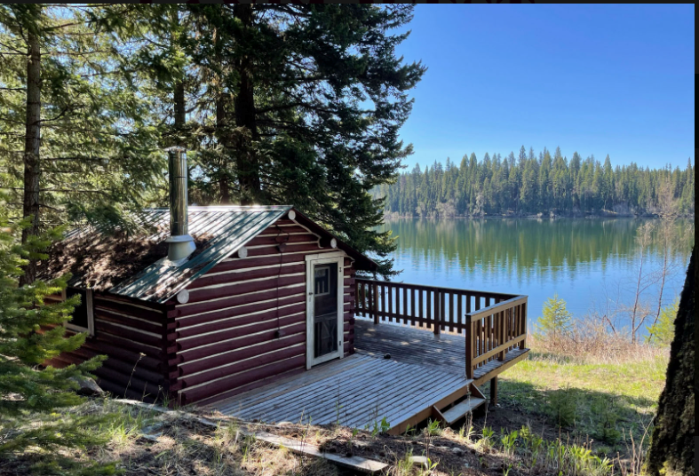 Fawn Lake: 10-acre waterfront parcel with two cabins in the Cariboo.| LandQuest Realty