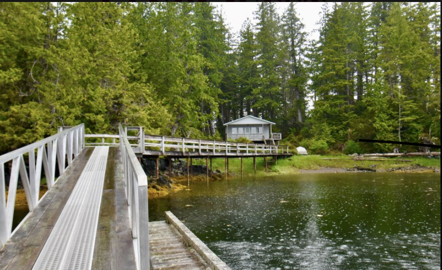 Private island in Lama Passage features two oceanfront cottages.   LandQuest Realty