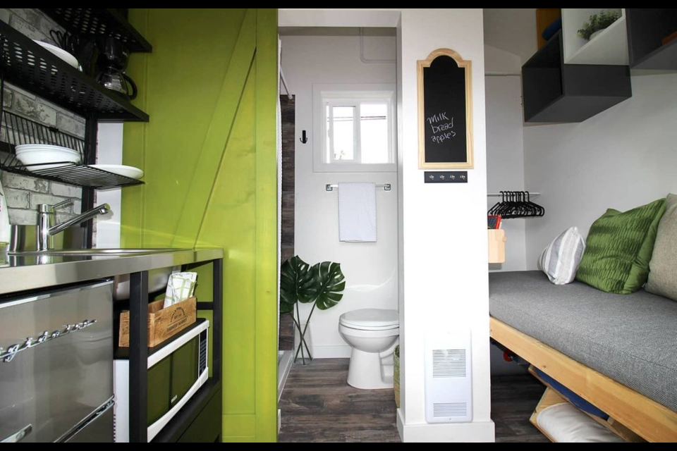 Full-size appliances fit into the small space.| Dwelltech